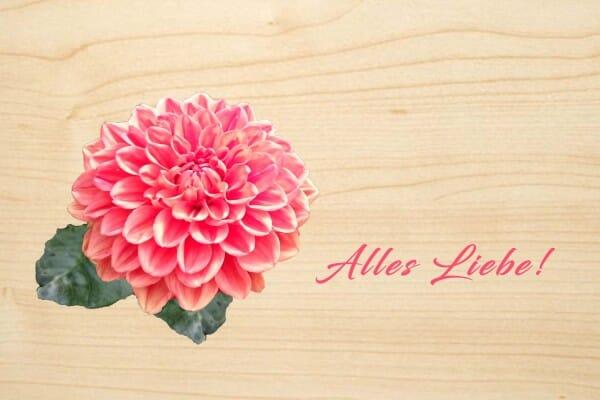 Holzgrusskarte - Hochzeit - Alles Liebe ! Rosafarbene Blume abgebildet.