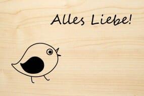Holzgrusskarte - Glück - Alles Liebe! Mit Vogel abgebildet.