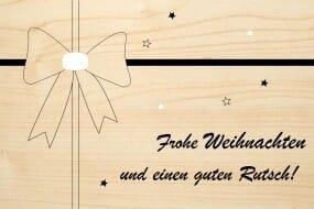 Holzgrusskarte - Weihnachten - Frohe Weihnachten und einen guten Rutsch! Masche abgebildet.